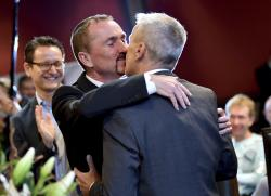 Karl Kreile, left, and Bodo Mende kiss after their marriage in Berlin.