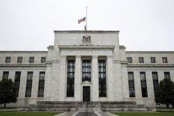In this May 22, 2020, file photo, the Federal Reserve building is viewed in Washington