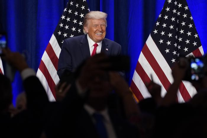 President Donald Trump smiles after a Latinos for Trump event at Trump National Doral Miami resort, in Florida.