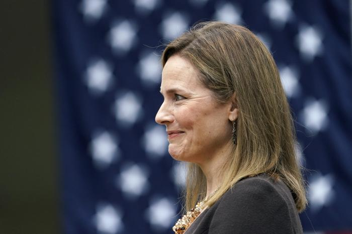 Judge Amy Coney Barrett listens as President Donald Trump announces Barrett as his nominee to the Supreme Court, in the Rose Garden at the White House.