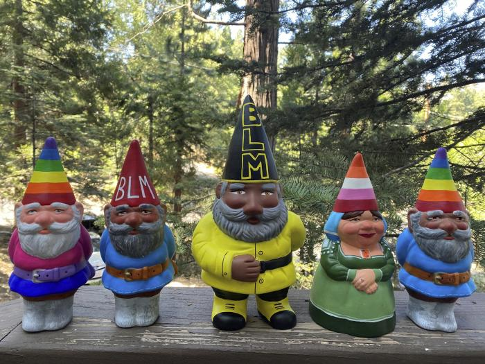 Black Lives Matter gnomes and gay pride gnomes he painted and is selling online.