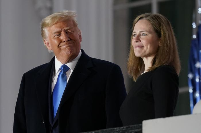 President Donald Trump and Amy Coney Barrett stand on the Blue Room Balcony