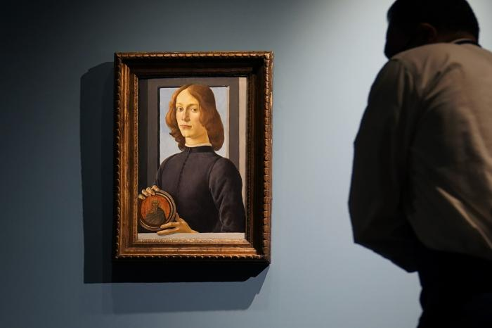 "Sandro Botticelli's 15th-century painting called ""Young Man Holding a Roundel"" is displayed at Sotheby's, in New York."