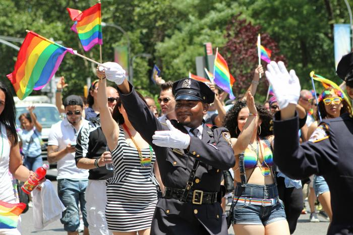 In this Sunday, June 29, 2014 file photo, NYPD police officers march along Fifth Avenue during the gay pride parade in New York.