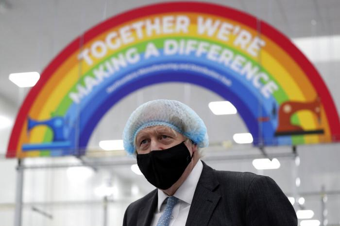 Britain's Prime Minister Boris Johnson, wearing a face mask to prevent the spread of the coronavirus, visits a PPE manufacturing facility during a visit to the north east of England.