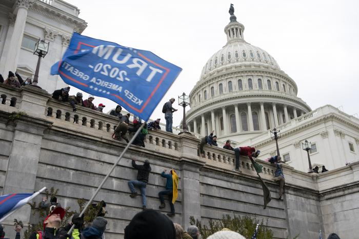 In this Jan. 6, 2021 file photo, violent insurrectionists loyal to President Donald Trump scale the west wall of the the U.S. Capitol in Washington. (AP Photo/Jose Luis Magana, File)