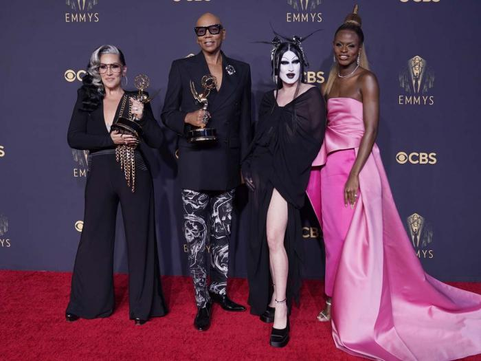 """Michelle Visage, from left, RuPaul Charles, Gottmik, and Symone pose for a photo with the award for outstanding competition program for """"RuPaul's Drag Race"""" at the 73rd Primetime Emmy Awards on Sunday, Sept. 19, 2021, at L.A. Live in Los Angeles"""